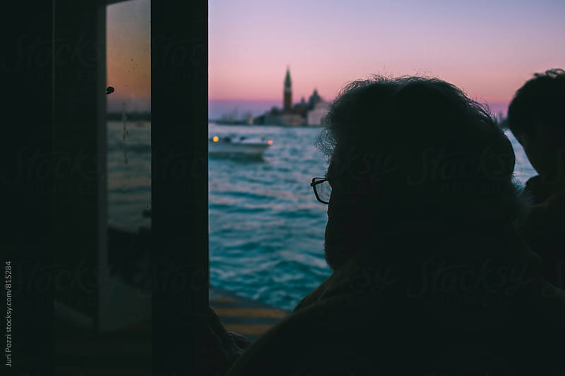 Old man silhouette on a ferry boat by Juri Pozzi for Stocksy United