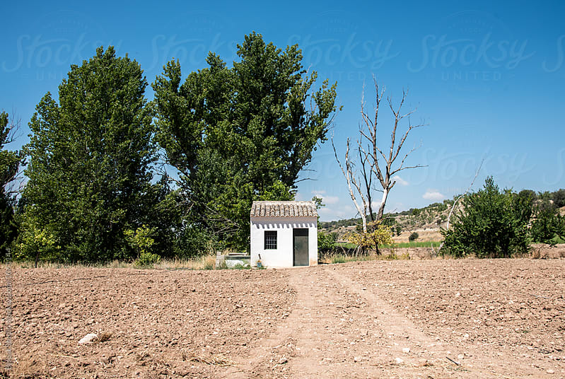 Small white house in a field around Granada by Bisual Studio for Stocksy United