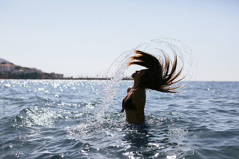 Side view of a woman enjoying the summer on the sea. by BONNINSTUDIO for Stocksy United