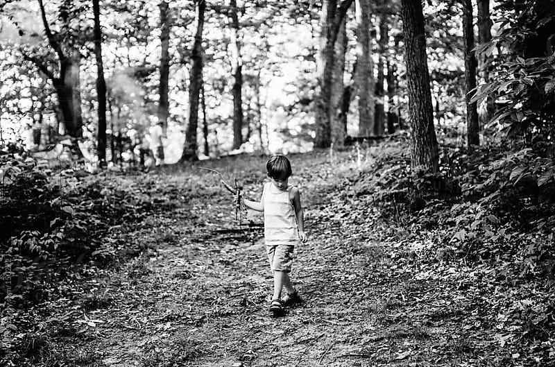 Boy Walking Down a Hill by Ali Deck for Stocksy United