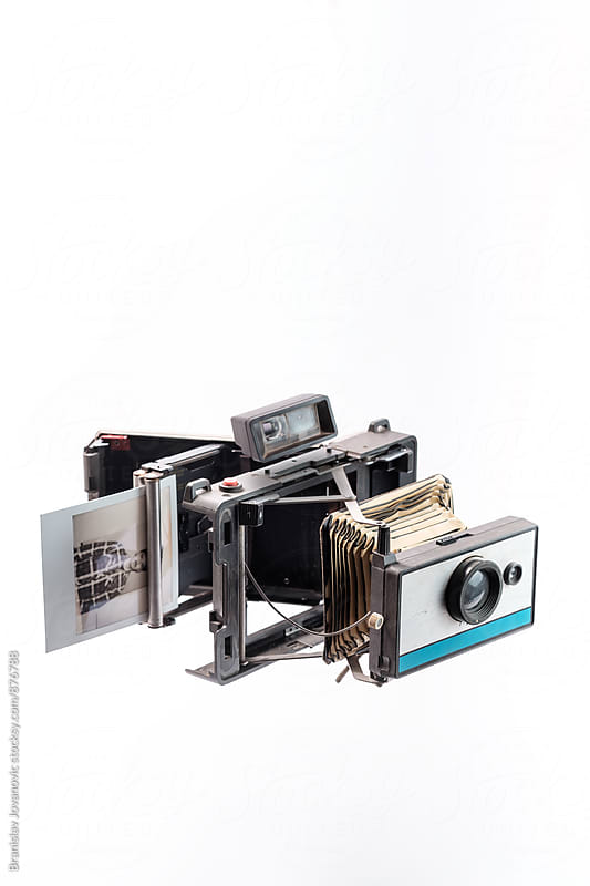 Disassembled Polaroid Camera on the White Background by Brkati Krokodil for Stocksy United