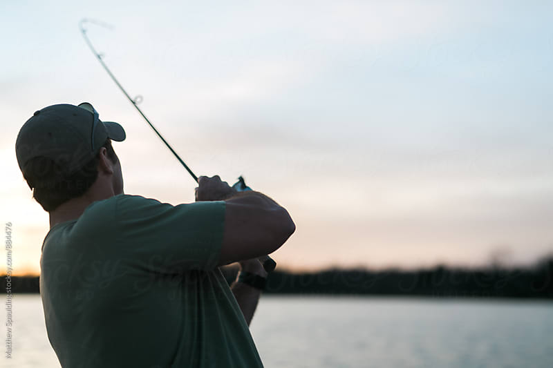 Man catching fish with rod by Matthew Spaulding for Stocksy United