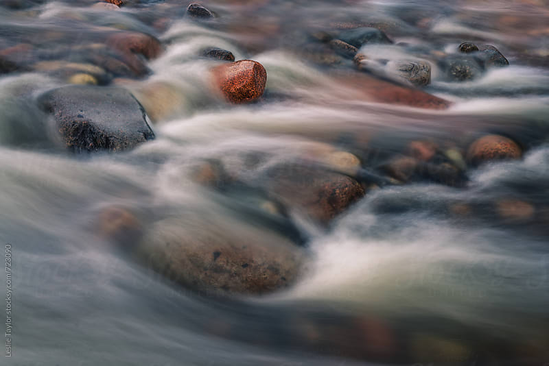 Water Flows Over Rocks In A River by Leslie Taylor for Stocksy United