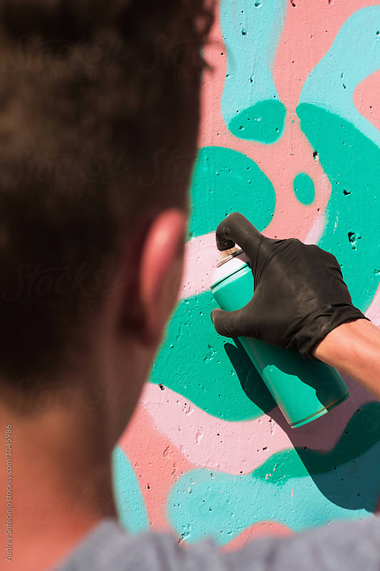 Close up of graffiti artist painting wall. by Marko Milanovic for Stocksy United