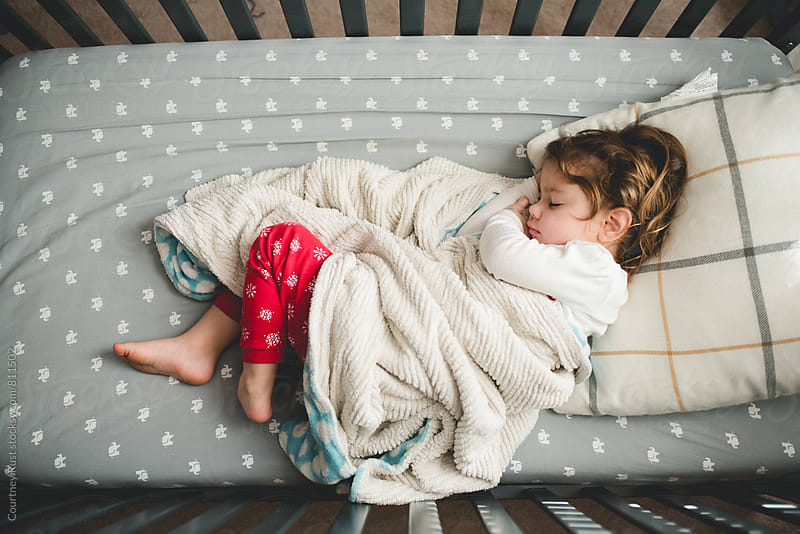 Snuggled in Christmas jammies by Courtney Rust for Stocksy United