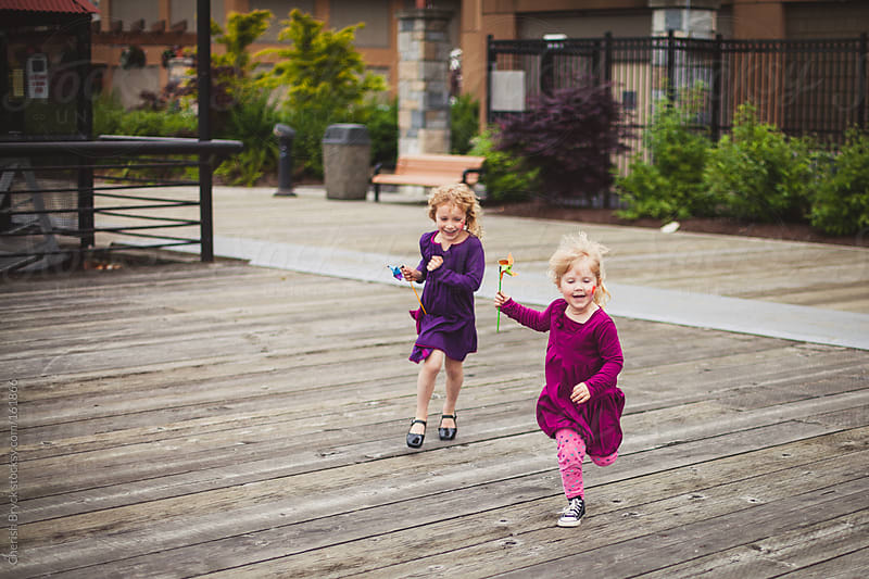 Playtime with a pinwheel. by Cherish Bryck for Stocksy United