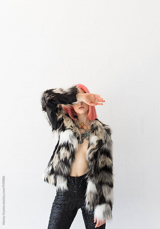 cool young woman with pink hair by Vesna for Stocksy United