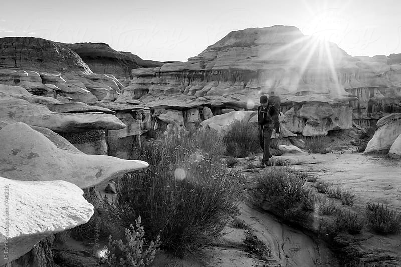 Backpacker Hiking in Bisti De Na Zin Wilderness Area New Mexico at Sunrise Black and White by JP Danko for Stocksy United