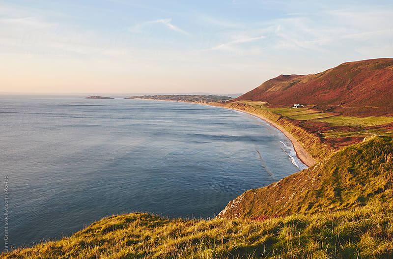 Rhossili beach at sunset. Wales, UK. by Liam Grant for Stocksy United