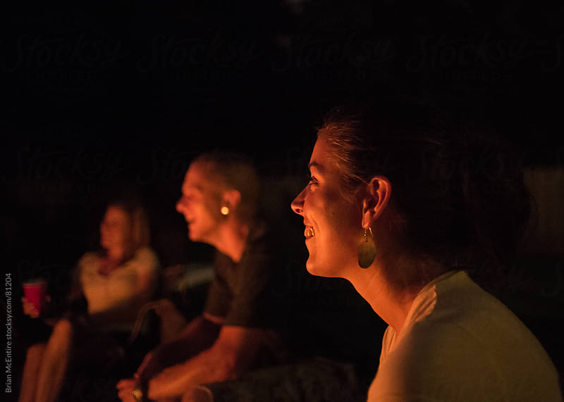 Mid 20s Aged Friends In the Warm Glow of a Campfire by Brian McEntire for Stocksy United