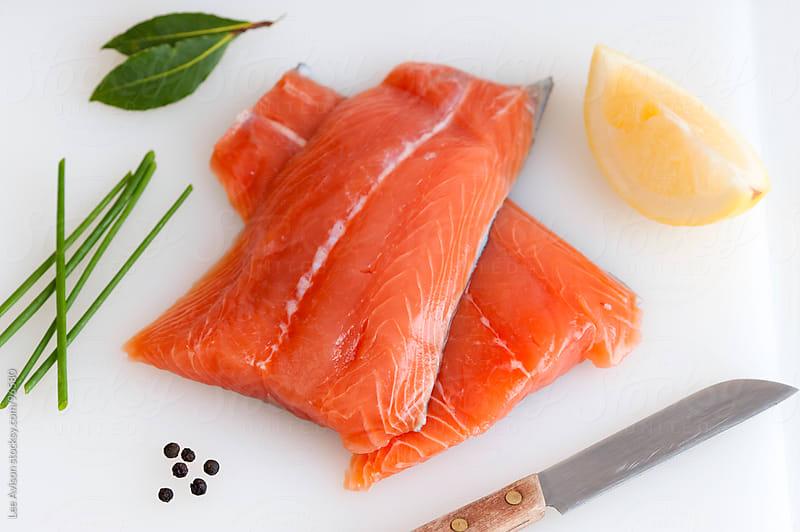 fresh raw salmon fillets by Lee Avison for Stocksy United
