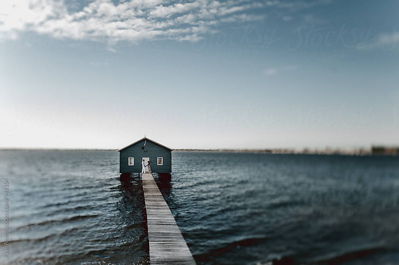 Blue Boat Shed on a Blue River with Blue Sky by Ryan Ahern for Stocksy United
