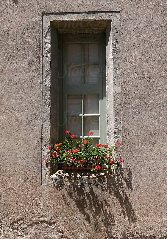 French house decorated with flowers by Marcel for Stocksy United