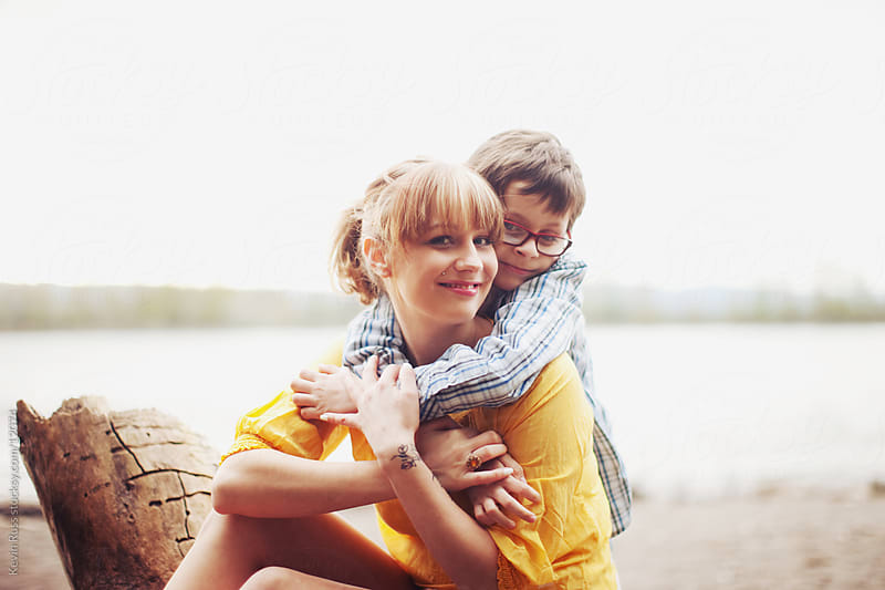 Boy Hugging Mom on Beach by Kevin Russ for Stocksy United
