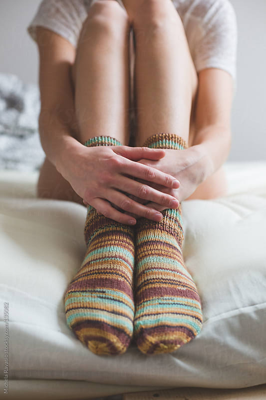 Young woman wearing socks by michela ravasio for Stocksy United