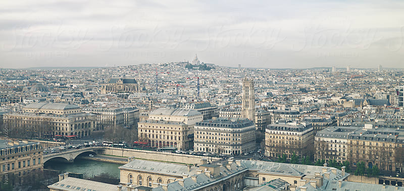 Paris skyline seen from Notre Dame cathedral by Ivan Bastien for Stocksy United
