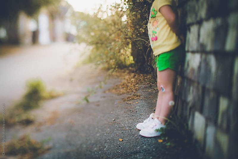 Little girl lost in an alley. by Cherish Bryck for Stocksy United