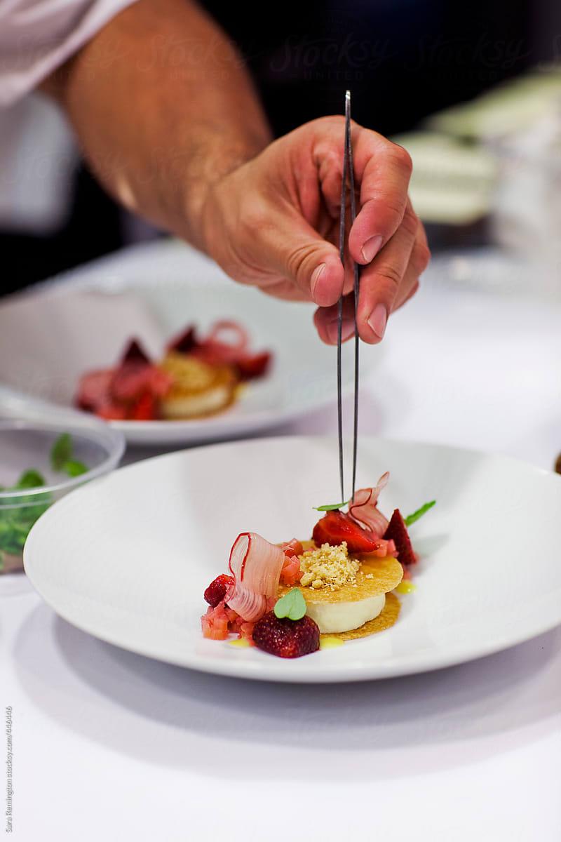 Chef Plating Dessert In Five Star Restaurant By Sara Remington Stocksy United