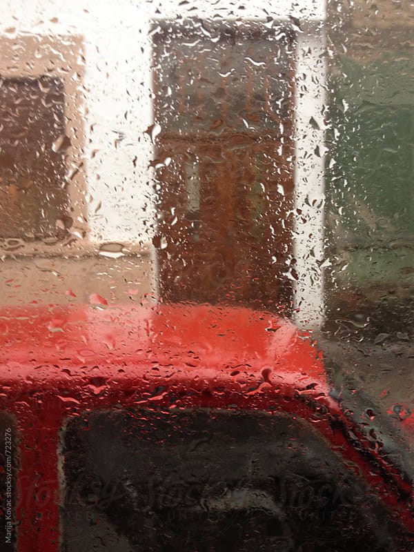 Raindrops on the window by Marija Kovac for Stocksy United