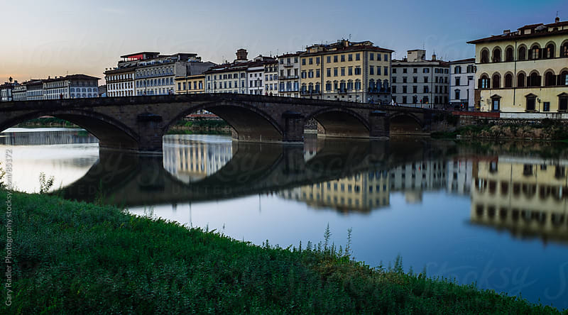 Arched Bridge  and reflections on the Amo River, Florence by Gary Radler Photography for Stocksy United