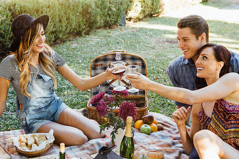 Friends at a Picnic by Jayme Burrows for Stocksy United