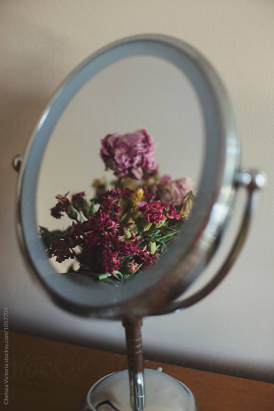 A reflection of flowers in a mirror by Chelsea Victoria for Stocksy United
