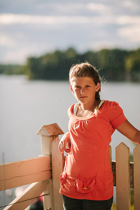 Portait of Yound Teen Girl at Lake Vacation home by Raymond Forbes LLC for Stocksy United