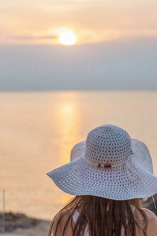 Anonymous Woman Enjoying Sunset at the Beach by Mosuno for Stocksy United