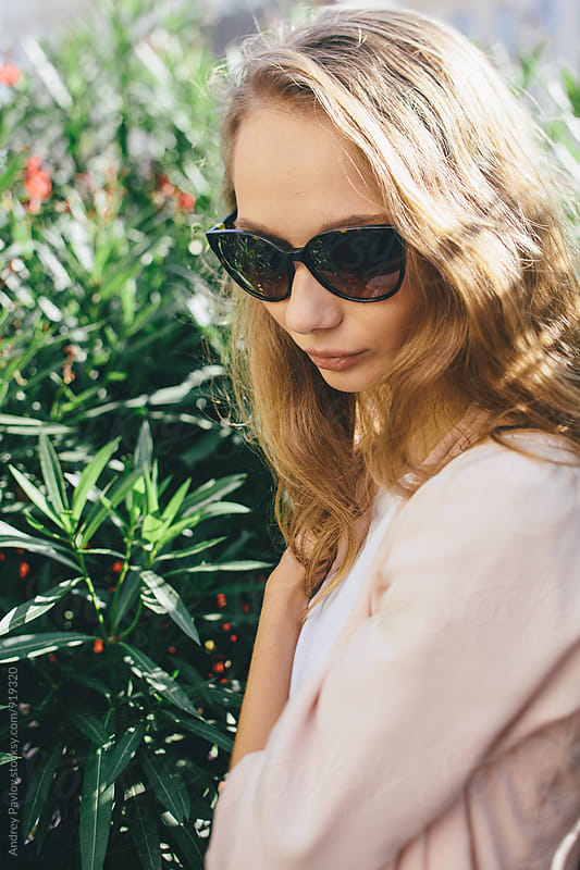 Close-up of young blonde woman in sunglasses by Andrey Pavlov for Stocksy United