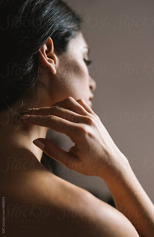 Young woman touching her neck with the hand by GIC for Stocksy United