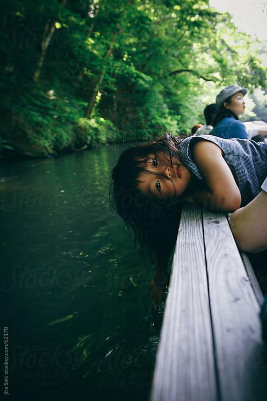 girl in the boat by jira Saki for Stocksy United