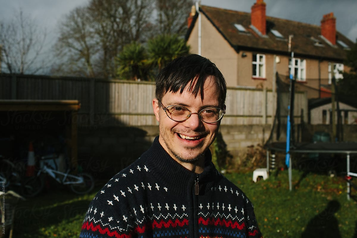 A Happy Smiling Man With Down Syndrome In Garden. | Stocksy United