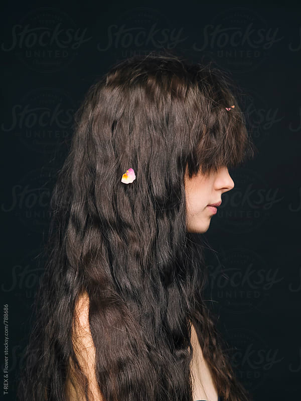 Close-up of brunette woman against of black background by Danil Nevsky for Stocksy United