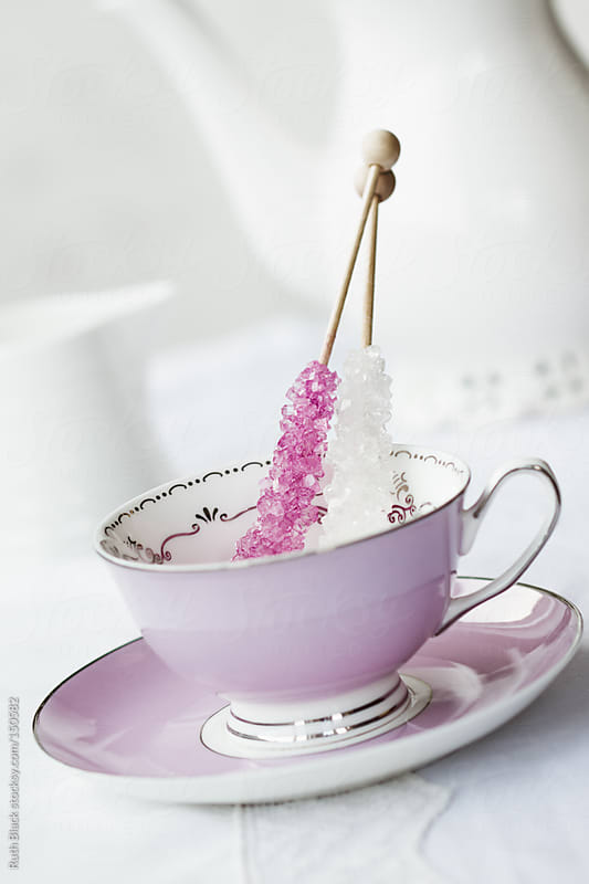 Rock crystal candy sticks in a vintage teacup by Ruth Black for Stocksy United