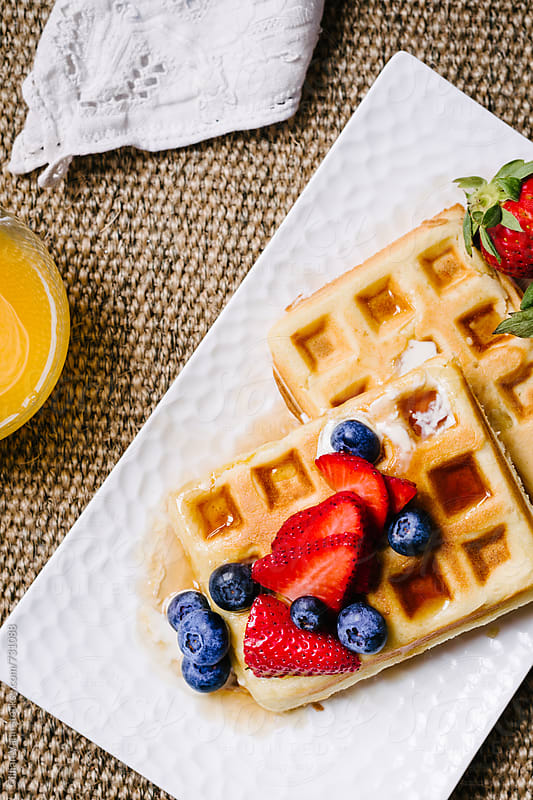 breakfast of waffles with fruit by Gillian Vann for Stocksy United