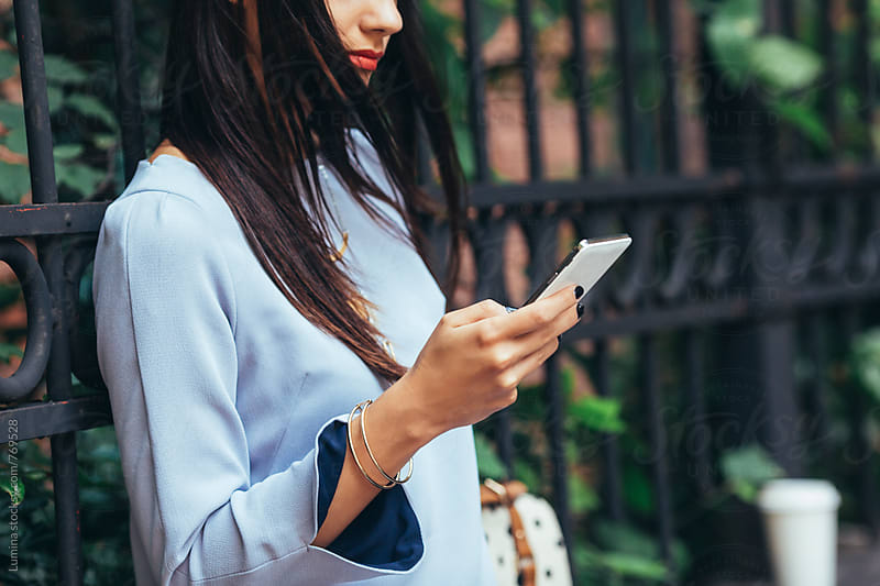 Elegant Woman Using a Smart Phone by Lumina for Stocksy United