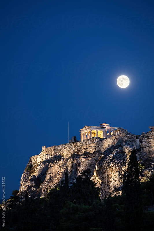 The full moon over the Acropolis in Athens, Greece by Helen Sotiriadis for Stocksy United