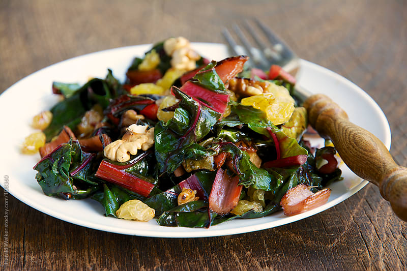 Sauteed Swiss Chard with Raisins and Walnuts by Harald Walker for Stocksy United