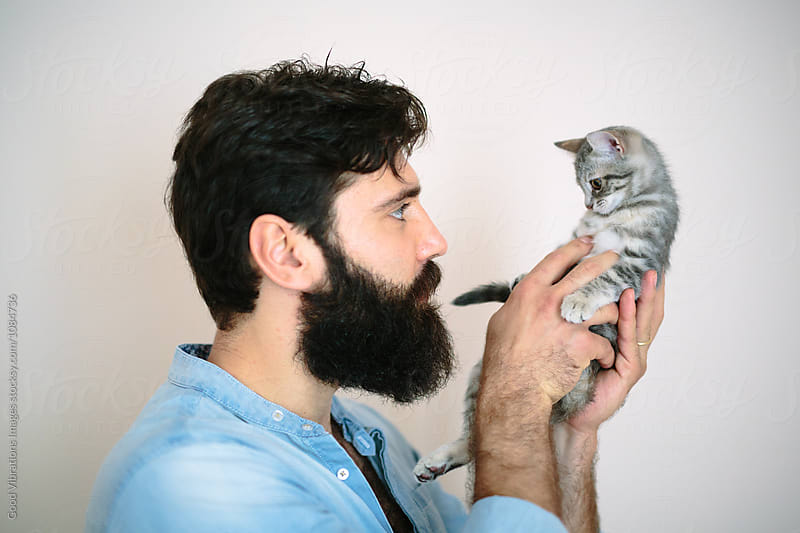 Bearded man with a kitten by Good Vibrations Images for Stocksy United