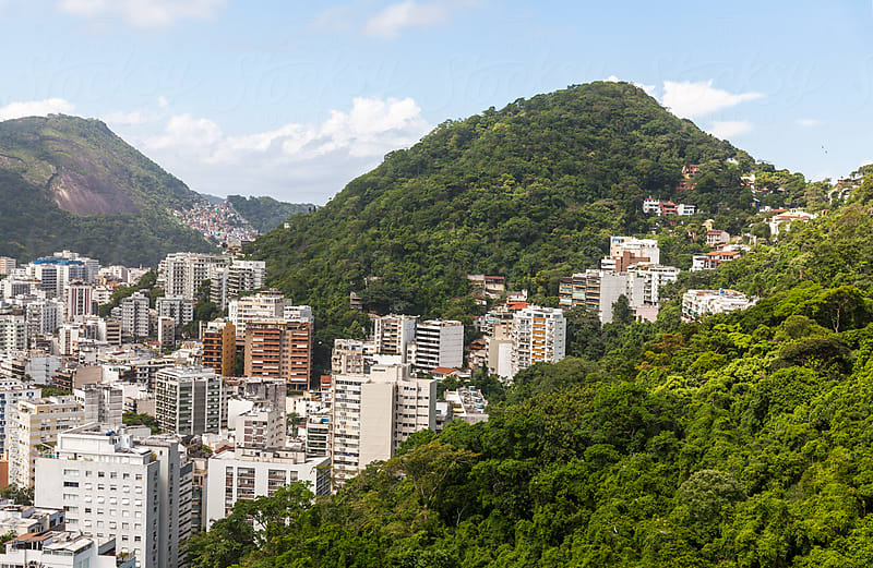 Rio de Janeiro sprawling amid jungle and mountains by Ben Ryan for Stocksy United
