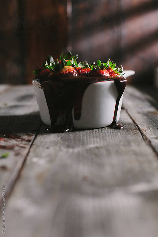 Preparing chocolate covered strawberries by Davide Illini for Stocksy United