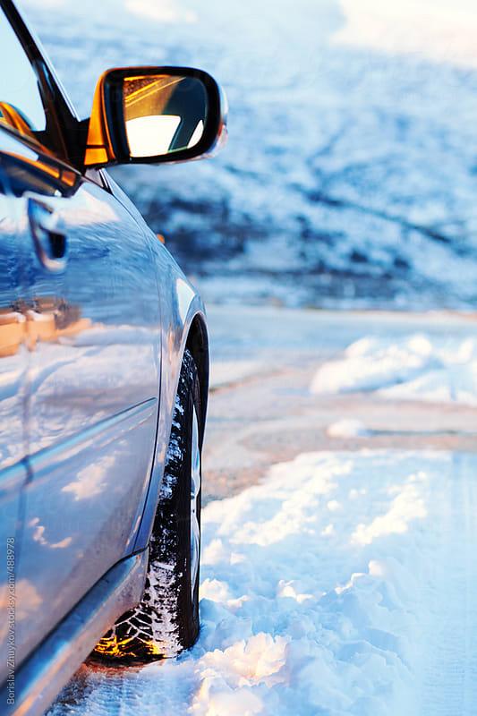 Car Detail On Snow Road by Borislav Zhuykov for Stocksy United
