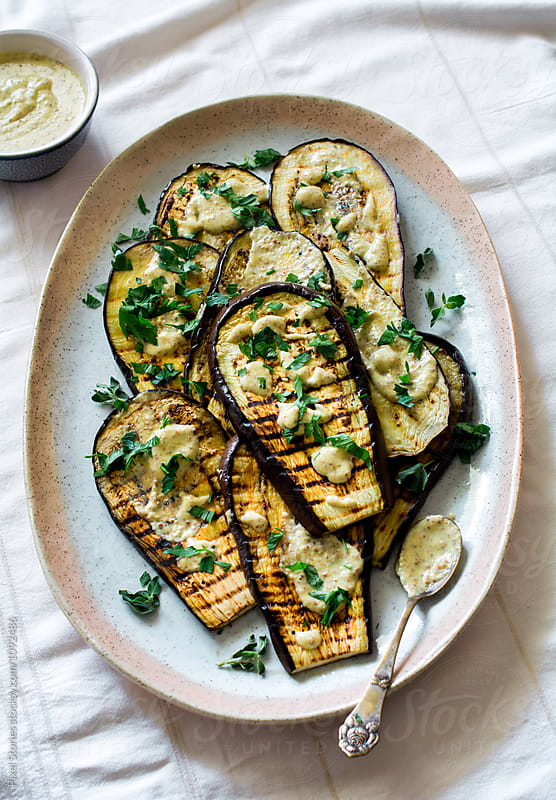 Grilled eggplant with mustard dressing  by Pixel Stories for Stocksy United