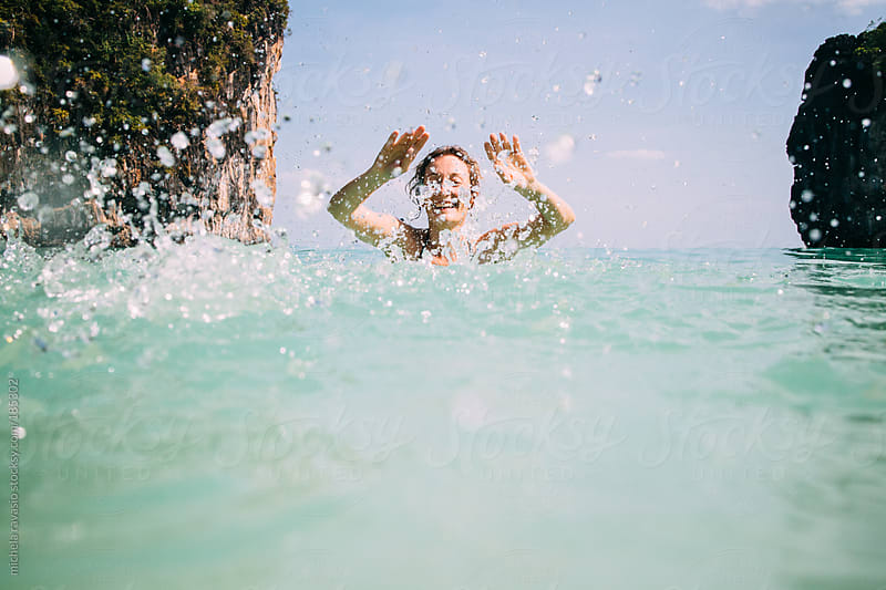 Woman having fun in the water by michela ravasio for Stocksy United