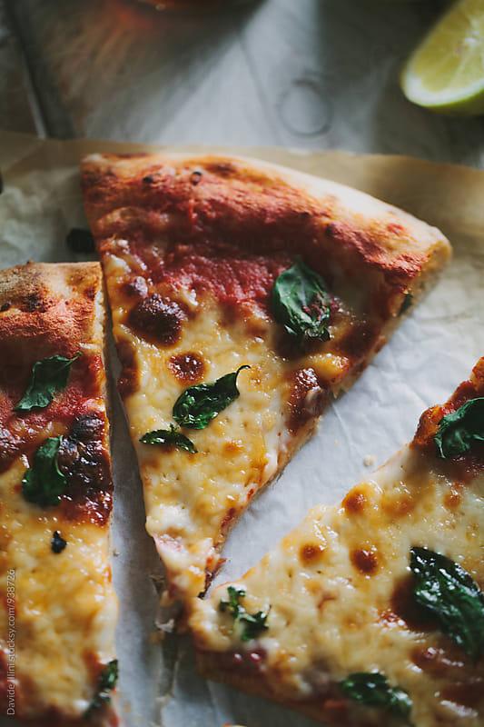 Italian pizza margherita by Davide Illini for Stocksy United