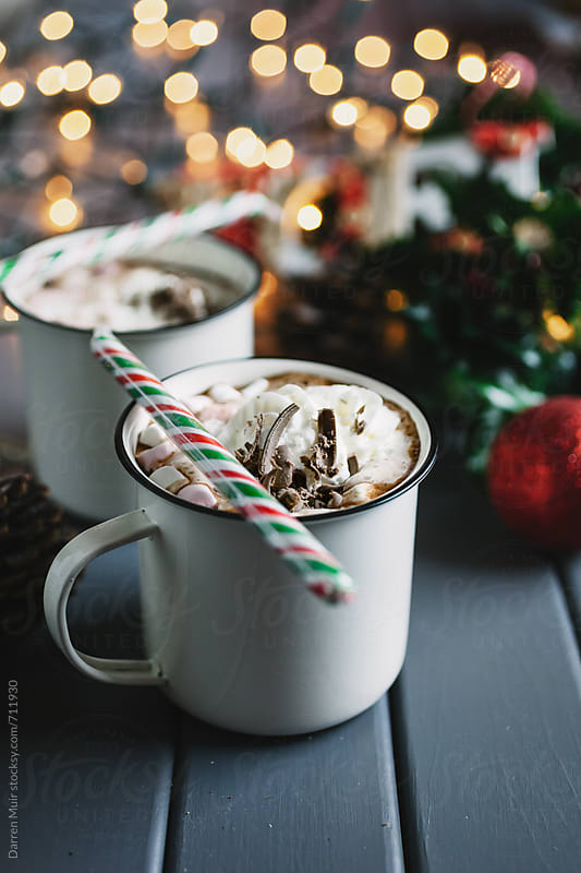 Hot chocolate drinks in a Christmas table setting. by Darren Muir for Stocksy United