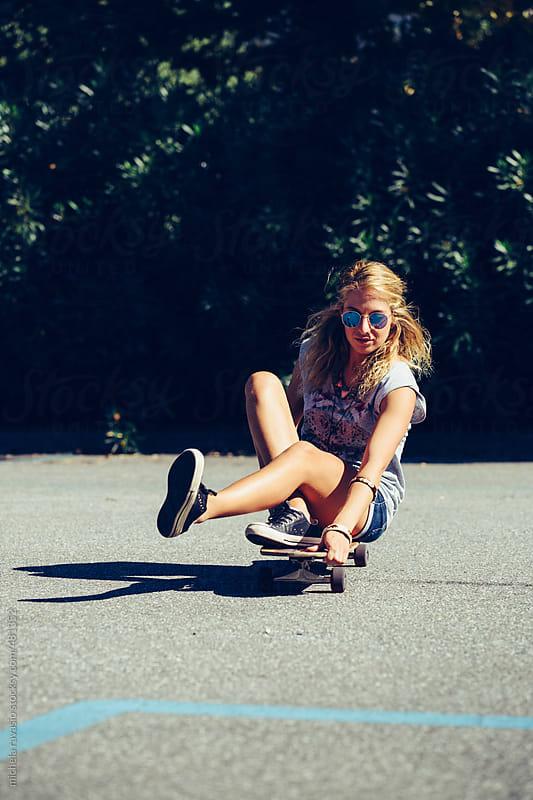 Blonde girl sitting on the skate by michela ravasio for Stocksy United