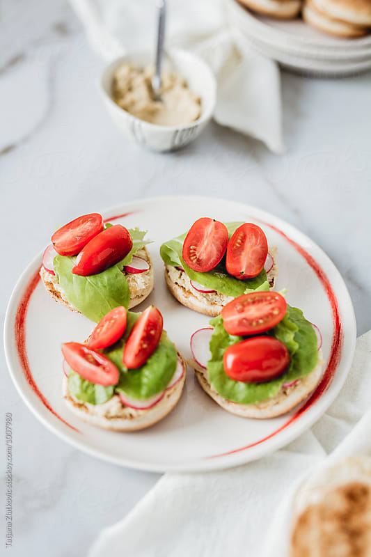 Making homemade vegan sandwiches by Tatjana Zlatkovic for Stocksy United