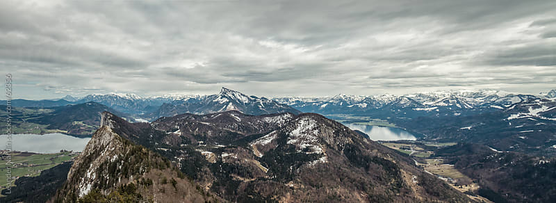 Panorama shot of an austrian alpine landscape covered in snow by Leander Nardin for Stocksy United