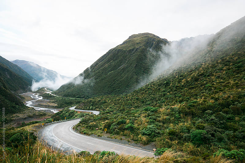Road winds through the mountains by Gary Parker for Stocksy United